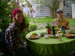 Erika and Evan enjoying lunch under trailer awning